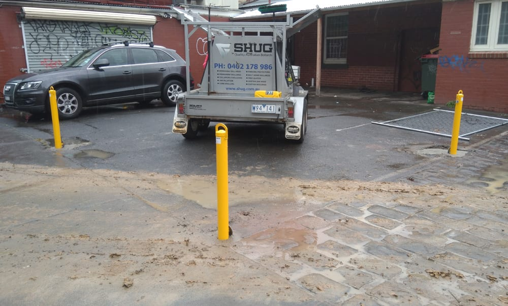 3 removable bollards installed as a protective boundary